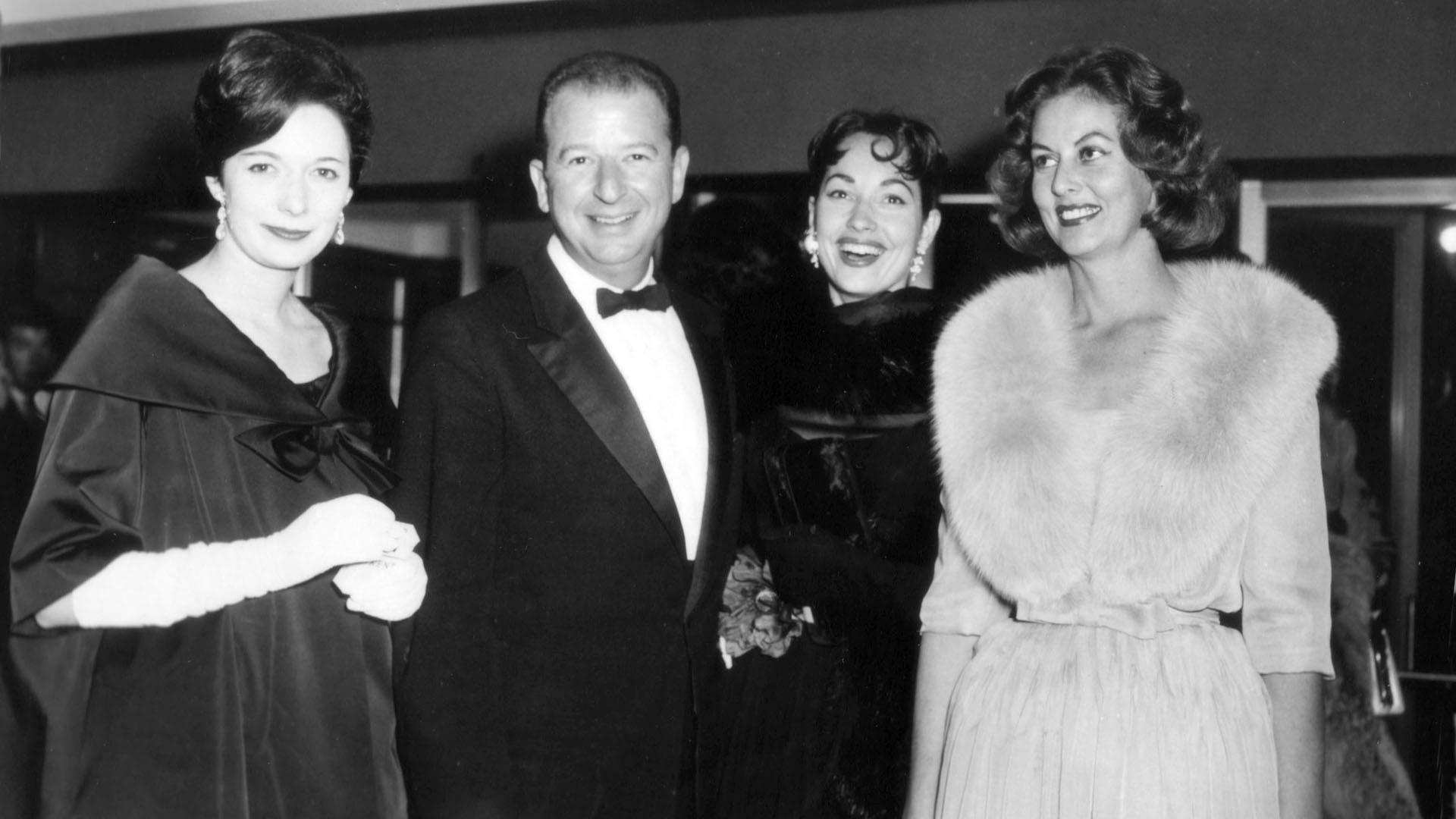 San Francisco Chronicle columnist Herb Caen (second from left) mingles with festival guests, including Phyllis Fraser (far right), at the 2nd San Francisco International Film Festival, 1959.