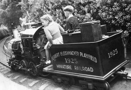 """""""Little Puffer"""" steam train at the zoo. Donated to the zoo by Herbert Fleishhacker in 1925, the miniature train ran in the zoo for 53 years, and then was put in storage. Through a generous grant from the Richard and Rhoda Goldman Fund, the train was repaired and restored. In 1997, it returned to delight zoo visitors. Courtesy of the San Francisco Zoo."""