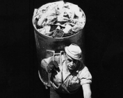 Uncle Pasquale Fontana. This picture, taken by the author, shows the typical tool the scavenger used to provide the service: an aluminum barrel with a shoulder hook that was individually shaped to conform to the physical contour of the scavenger. Courtesy of the author.