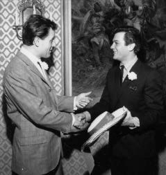 Dad with actor Tony Curtis, who is holding an H.M.S. Pinafore hat worn by the bartenders. Author's collection.