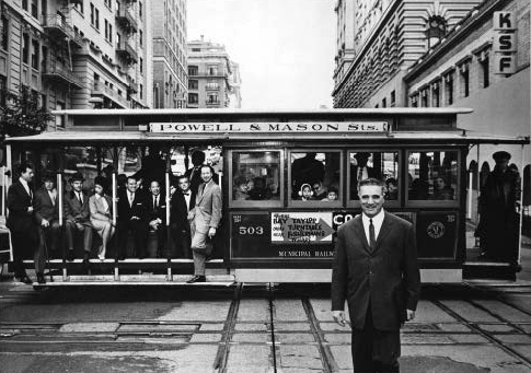 "A Holiday magazine photo showed ""important"" people in San Francisco, including Mayor George Christopher in the foreground and others on the cable car. From left, Joe Paoli; baseball great Frank ""Lefty"" O'Doul; restaurateur and writer Barnaby Contrad; model Lily Valentine; press agent Don Steele; polo-playing Charlie Low, owner of Forbidden City; advertising executive Howard Gossage; and columnist Herb Caen. Author's collection."